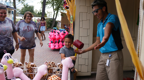A child winning a game at one of Carowinds' Halloween events for kids and families