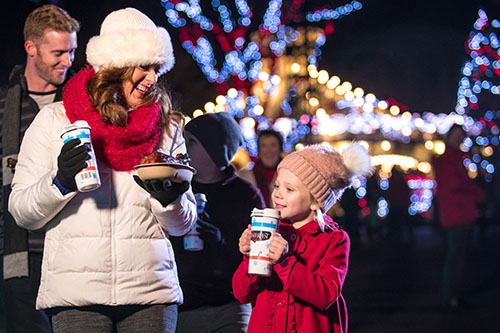 Family enjoying Kings Dominion's brand-new Holiday Event, WinterFest