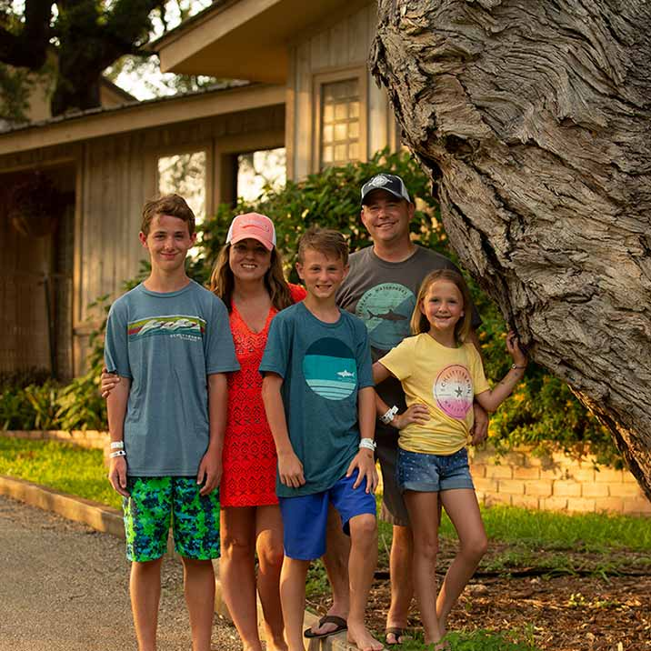 Family Standing Outside of Vacation Home at Schlitterbahn Waterpark New Braunfels