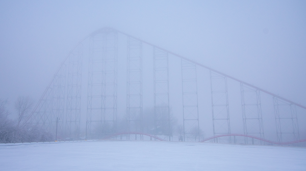 Snow and thick fog cover the height of Mamba, a Kansas City attraction at Worlds of Fun
